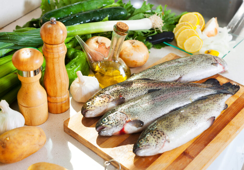 fresh trout fish in kitchen
