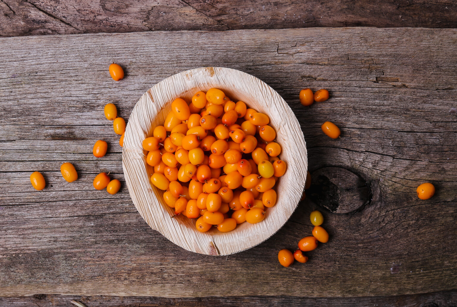Sea buckthorn on the wooden table
